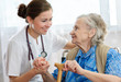 Senior woman is visited by her doctor or caregiver - 26242647