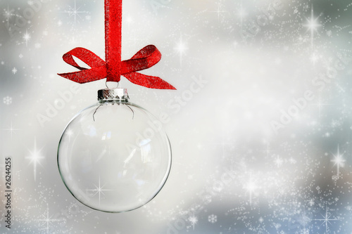 Leinwanddruck Bild Transparent Christmas ball ornament on snowy background