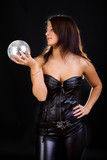 Sexy darkhaired female with discoball poster