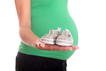 Pregnant Woman holding Little Shoes