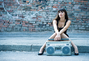 Woman with boom box on the street