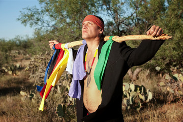 Native American man with colorful flags