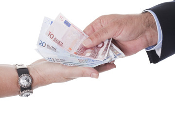 two hands holding european money