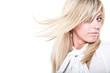 Model posing on white and her hair flutter
