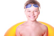 very happy kid in swimming glases and circle