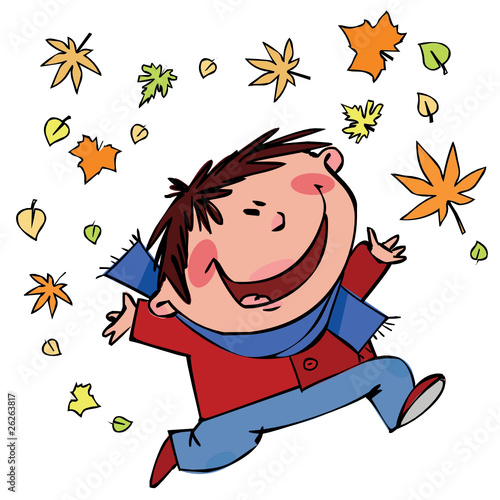 Cheerful boy with autumn leaves