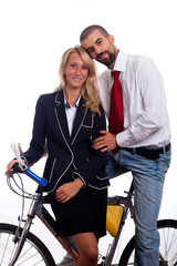 Young Businessman and Businesswoman on a Bike