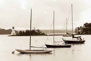 Boats and lighthouse on Bras D'Or lake, Cape Breton, Nova Scotia