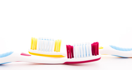 red and yellow toothbrush
