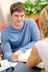 Portrait of a self-assured student working with his friend in th