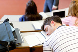 Fototapety Asleep male student during an university lesson