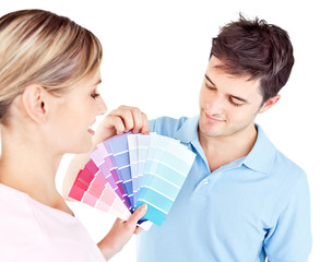 Enamored couple choosing color for a room