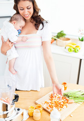 Radiant mother preparing vegetables for her adorable baby