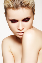 Portrait of fashion model with dark cherry gloss make-up