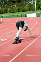 Concentrated man waiting in starting block
