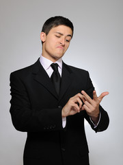 Young handsome business man in a formal suit counting on fingers