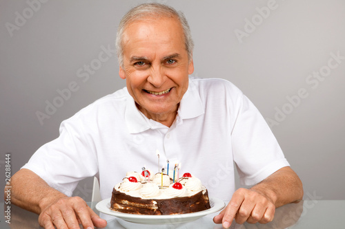 Mature man with a cake