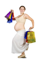 pregnant woman holding shopping bags.