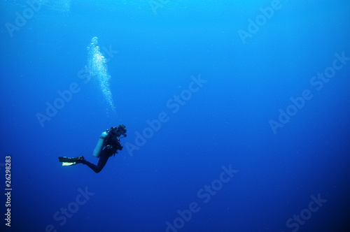scuba diver in deep blue water - 26298283