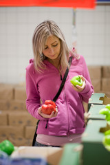 Beautiful young woman shopping for fruits and vegetables in prod