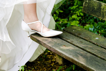 Bride showing off wedding shoes