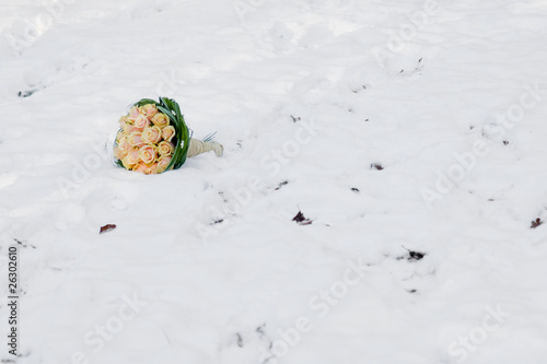 Winter wedding bouquet in snow