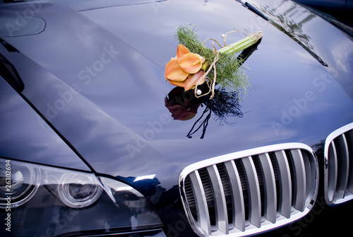 Wedding car with bridal bouquet