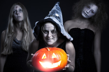 halloween personages over dark background