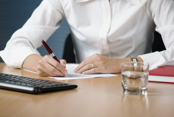 Businesswoman signing documents
