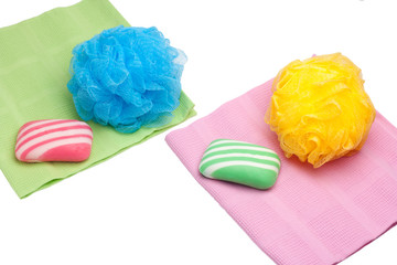 Two towels, sponge and soap on a white background.