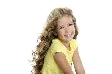little blond girl smiling portrait yellow tshirt isolated on whi