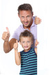 Closeup of man with little boy showing message