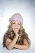Thinking gesture little girl winter pink cap portrait