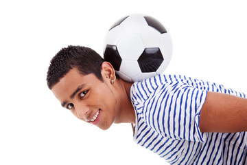 handsome latin boy holding a soccer ball