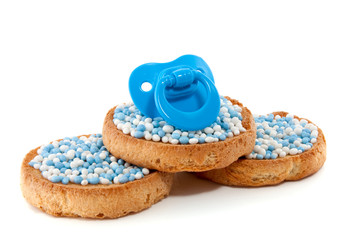 baby pacifier on top of Dutch Birth biscuits