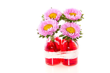 Pink daisies in glass vases