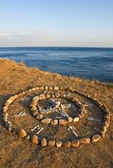old pagan sign on a sea coast