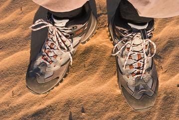 closeup hiker feet on a sand