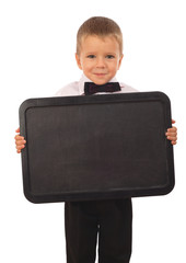 Little boy with empty chalkboard, isolated on white