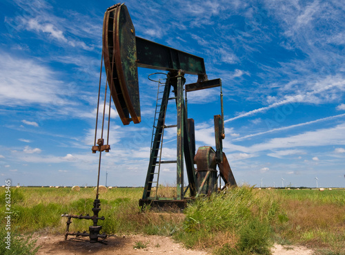 canvas print picture Pump jack in a field