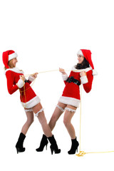 Two sexual girls in Christmas clothes .