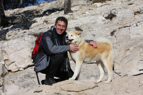 japanese akita with a friend on the mountain