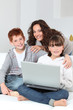 Mother and children surfing on internet