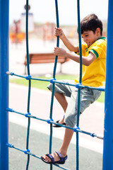 Young boy on playstructure