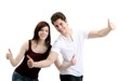 pleasant young couple - thumbs up (white background)