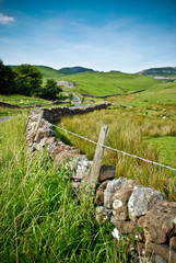 Yorkshire dales stone wall with bright blue sky