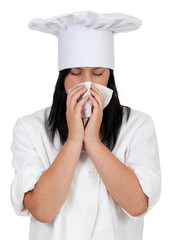 female cook in white uniform and hat with snotty, runny nose.