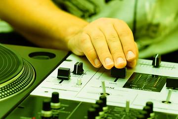 Hands of a dj adjusting the crossfader