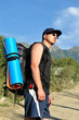Tourist with a large backpack is a high mountain, on the road,