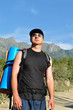 Tourist with a large backpack is a high mountain, on the way,